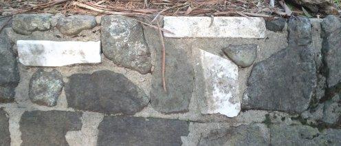 WPA walls incorporated stones and gravestones.