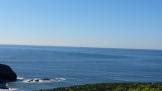 Farallones Islands on the horizon.