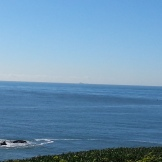 Farallones Islands on the horizon.
