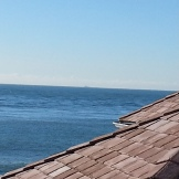 Across the lightkeeper's roof to the Farallones.