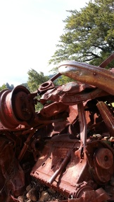 Cool car wreck out in the middle of nowhere.