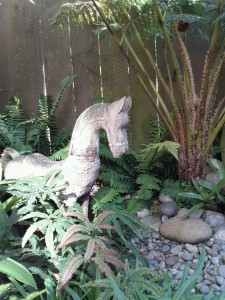 Wooden horse in our fern grotto.
