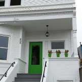 Growing up in Mendocino County, I developed a love for Victorians painted white on white. I love these green pots, with the door painted to match. Reminds me of the Mendo coast.