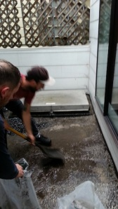 Colin and Tony, scraping sludgy dirty gravel in the rain. I love supervising. :)