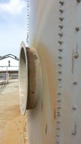 Portal in the side of a gigantoid tank.