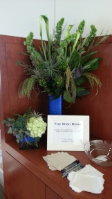 Entry table arrangements, stage left, with a bowl for guests to drop in well-wishes for the grooms.