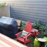 During: Furniture waits in the unplanted garden to find a home on the deck once it's stained.