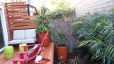 Inviting and colorful furniture draws you out to enjoy the garden.
